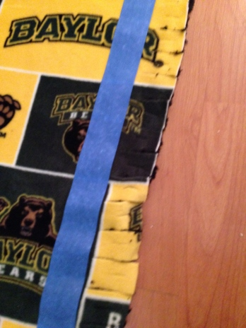 Cutting the Baylor fleece and the black fuzzy fleece